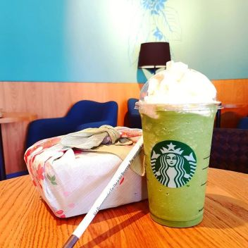 redeeming a free drink: matcha frappuccino with whipped cream